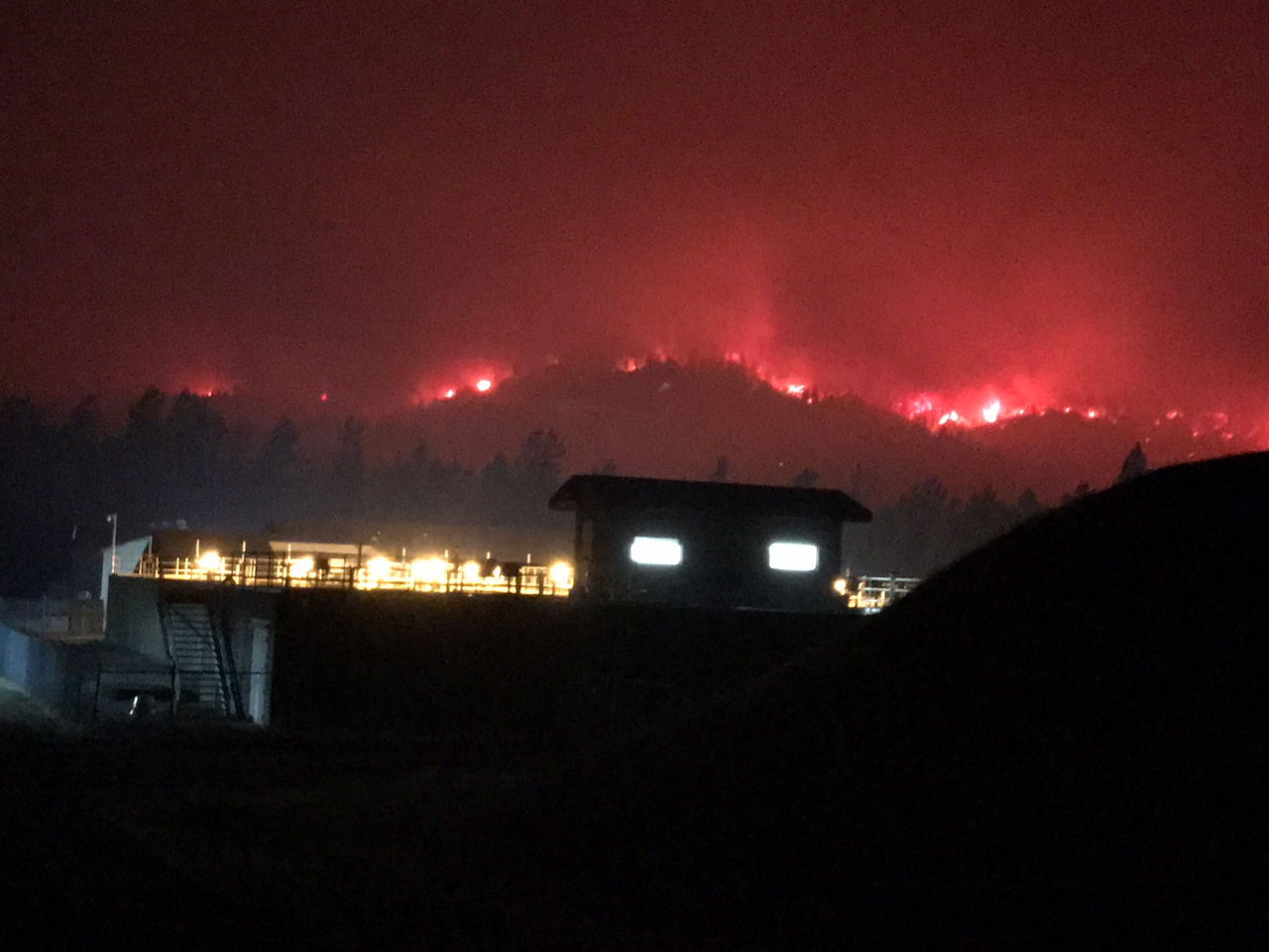 A nighttime image of the fire around Buckeye Water Treatment Plant. (Photo by Richard Hinrichs of the State Water Resources Control Board)