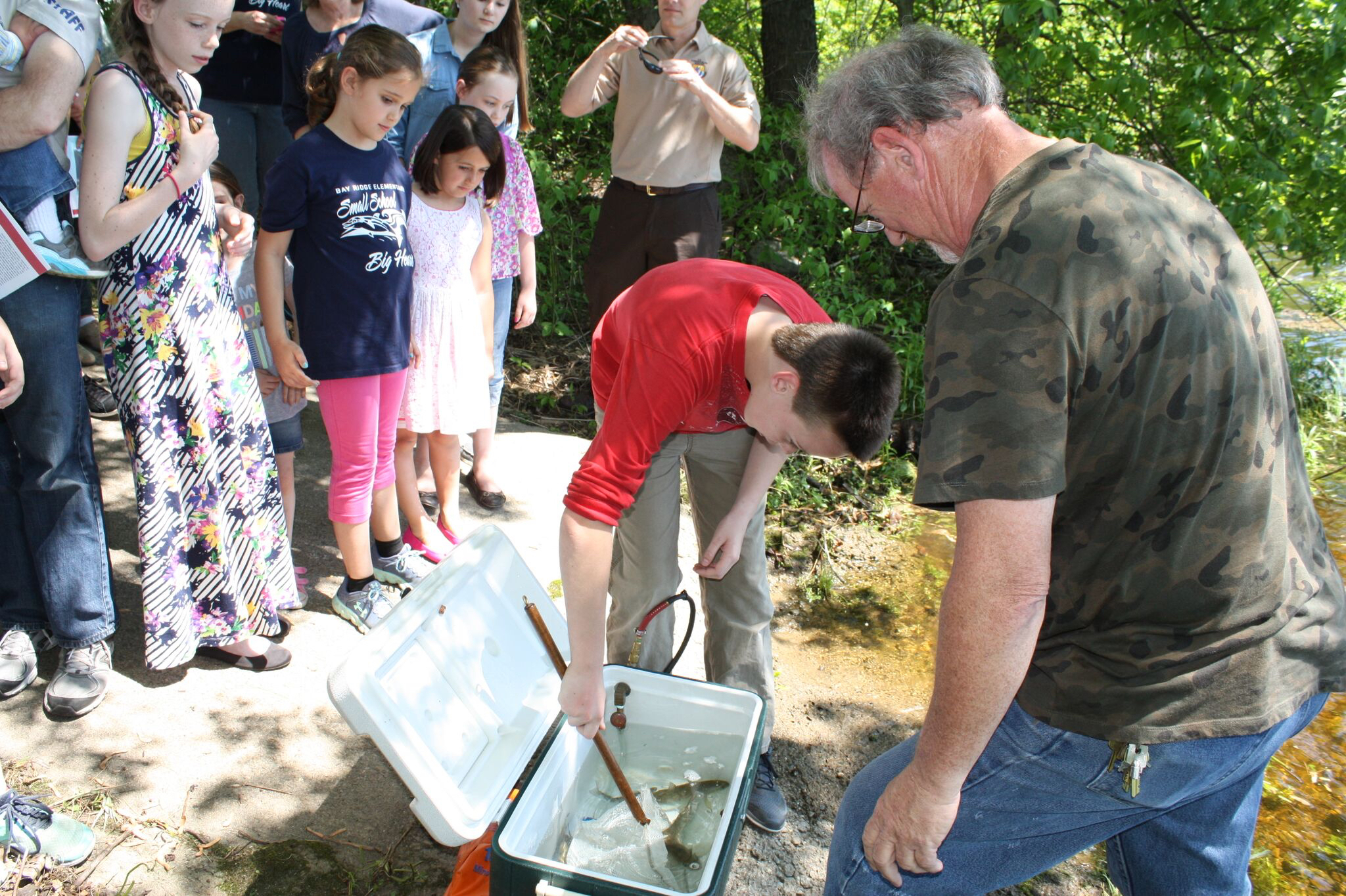 Local children participate in the release of the plant's Atlantic salmon into the Penobscot River.